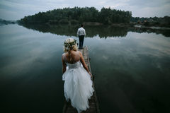 Wedding couple on the old wooden pier Royalty Free Stock Photos