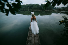 Wedding couple on the old wooden pier Stock Image