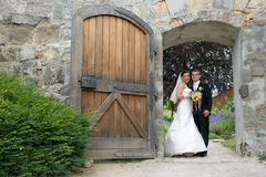 Wedding couple open gate Stock Photo
