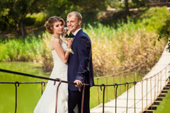 Wedding couple outdoors on bridge Stock Photography