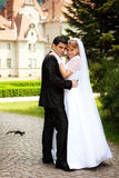 Wedding couple outdoors on their wedding day Royalty Free Stock Photo