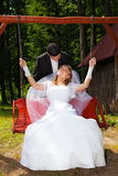 Wedding couple outdoors on their wedding day Stock Photos