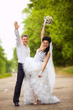 Wedding couple at a par Royalty Free Stock Photo