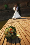 Wedding couple in the park. Focus on bouquet Royalty Free Stock Photography