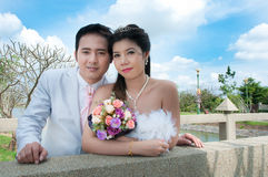 Wedding couple in the park in thailand Royalty Free Stock Image