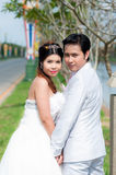 Wedding couple in the park in thailand Royalty Free Stock Photo