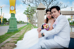 Wedding couple in the park in thailand Royalty Free Stock Photos