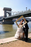 Wedding couple and a photo frame Stock Photo