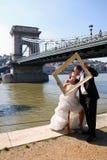Wedding couple and a photo frame Stock Photo