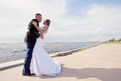 Wedding couple on pier Stock Photography