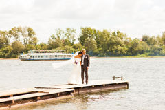 Wedding couple  on the pier near big lake Stock Photo
