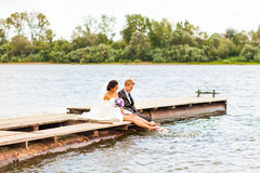 Wedding couple  on the pier near big lake Stock Photography