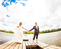 Wedding couple  on the pier near big lake Royalty Free Stock Images