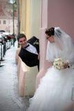 Wedding couple playing hide and seek stock image