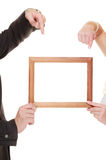 Wedding couple pointing empty frame for photos. Stock Photo