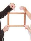 Wedding couple pointing empty frame for photos. Royalty Free Stock Image
