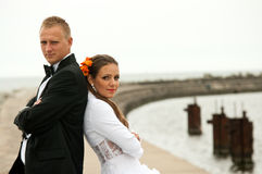 Wedding couple in port. Portrait of attractive wedding couple in a port royalty free stock photography