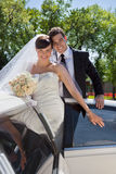 Wedding Couple Portrait with Limo Royalty Free Stock Photos