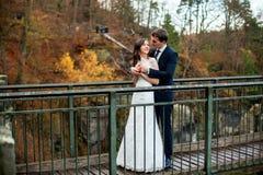 Wedding couple posing against the backdrop of the mountain. Bride waving hair royalty free stock photos