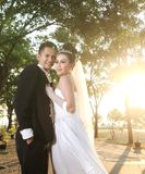 Wedding couple posing outdoor stock photo