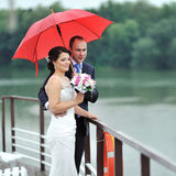Wedding couple in a rainy day Royalty Free Stock Photography