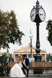 Wedding couple relaxing on a bench Stock Image