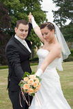 Wedding couple rise arms together. Wedding couple together rising arms, look at bouquet stock photography