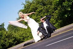 Wedding couple on the road Stock Images