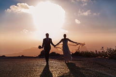 Wedding couple on the road, sunset light Stock Photography