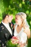 Wedding couple in romantic setting Stock Photos