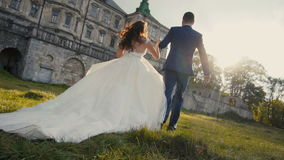 Wedding Couple Runing. On sunset before old castle stock video footage