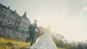 Wedding Couple Runing. On sunset before old castle stock footage