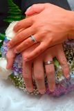 Wedding couple's hands Stock Photo
