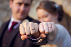 Married Couple Showing Wedding Rings. Strong Couple Fists Stock Photography