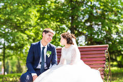 Wedding couple sitting on a bench Royalty Free Stock Photography