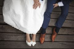 Wedding couple sitting on the pier Royalty Free Stock Photography