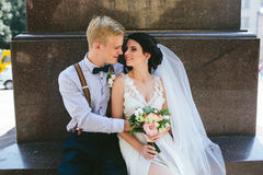 Wedding couple sitting Royalty Free Stock Images