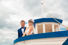 Wedding couple on small boat. The bride and groom on the ship Royalty Free Stock Photography