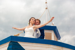 Wedding couple on small boat. The bride and groom on the ship Stock Image