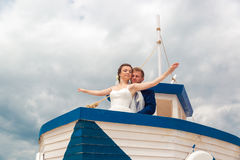 Wedding couple on small boat. The bride and groom on the ship Royalty Free Stock Image