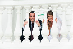 Wedding couple smile and look out from white baluster. Love tenderness feeling stock photos