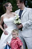 Wedding couple and son. Pictures shooten on a wedding day from a beautiful couple and child royalty free stock images