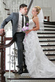 Wedding couple on stair Royalty Free Stock Image