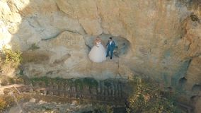 Wedding couple stand on a slope of the mountain hill. Lovely groom and bride royalty free stock photos