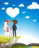 Wedding couple standing on cliff Stock Photo