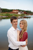 Wedding couple standing and hugging near lake Royalty Free Stock Photos