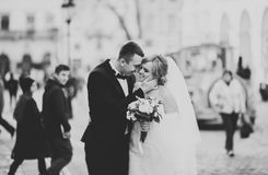 Wedding couple is standing and kissing in the streets of old city Stock Photography