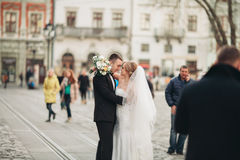 Wedding couple is standing and kissing in the streets of old city Stock Photo