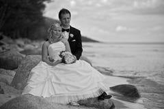 Wedding couple on stony beach Royalty Free Stock Image