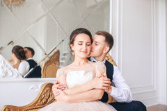 Wedding couple on the studio. Wedding day. Happy young bride and groom on their wedding day. Wedding couple - new family. Stock Photos